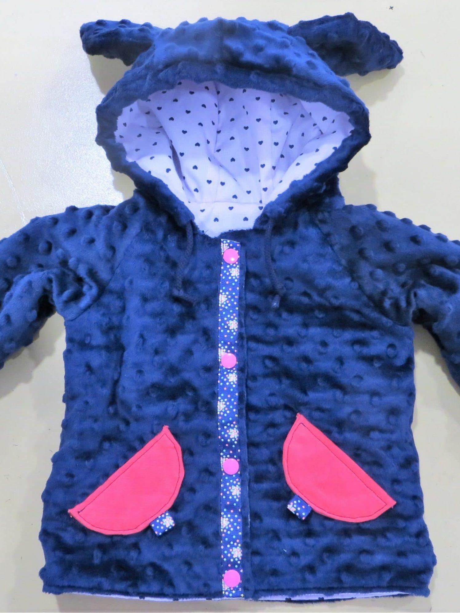 Une veste enfant réversible bleue